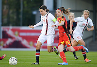 20140410 - LEUVEN , BELGIUM : Duel pictured between Norway Ingvild Stensland (left) and Belgian Nicky Van Den Abbeele (right) during the female soccer match between Belgium and Norway, on the seventh matchday in group 5 of the UEFA qualifying round to the FIFA Women World Cup in Canada 2015 at Stadion Den Dreef , Leuven . Thursday 10th April 2014 . PHOTO DAVID CATRY