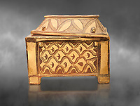 Minoan  pottery coffin chest coffin with gabled lid decorated with a net pattern,  Tylissos-Panokklisia 1350-1250 BC, Heraklion Archaeological  Museum, grey background.