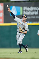 Charleston RiverDogs right fielder Austin Aune (22) throws the ball back to the infield during the game against the Hickory Crawdads at L.P. Frans Stadium on August 25, 2015 in Hickory, North Carolina.  The Crawdads defeated the RiverDogs 7-4.  (Brian Westerholt/Four Seam Images)