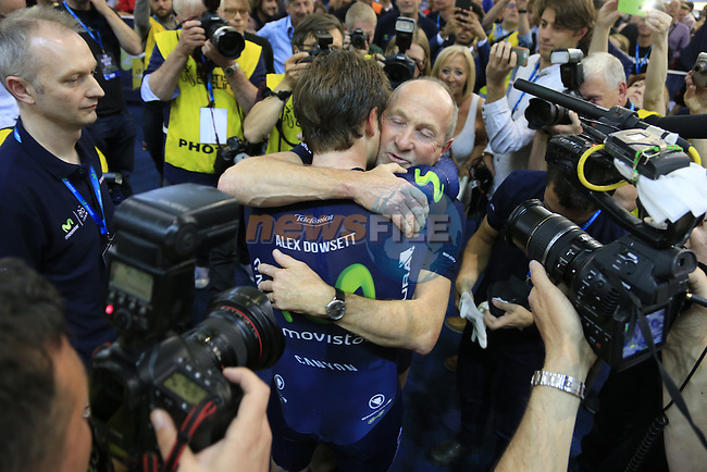 Alex Dowsett hugs his dad Phil after breaking the World Hour Record with a distance of 52.937km at the Manchester Velodrome British Cycling Centre. 2nd May 2015.<br />