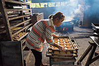 Ayem, Baker, Bago, Myanmar 2016<br /> Khin New Ayem is a baker in Bago. Her posture shows how the work is taking a toll. Her whole family helps run the business. Her husband runs deliveries on his motorbike and truck. Ayem used to run a small home-based bakery business, but she received microloan from BRAC for $150 two years ago, then another $1,500 that helped her grow her business. She nets about $700 a month, and with that, she pays her staff of twelve and supports her three children.