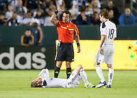 CARSON, CA - November 3, 2011: LA Galaxy midfielder David Beckham (23) goes down after being shaken up, while teammate Mike Magee (18) during the match between LA Galaxy and NY Red Bulls at the Home Depot Center in Carson, California. Final score LA Galaxy 2, NY Red Bulls 1.