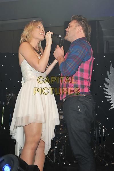 Daniel and Natasha Bedingfield.'Global Angels Awards', The Park Plaza Hotel, Westminster, London, England. 2nd December 2011..music on stage live concert gig performing half 3/4  length microphone   duet brother sister siblings strapless white dress pink blue tartan plaid shirt waistcoat tie .CAP/MAR.© Martin Harris/Capital Pictures.