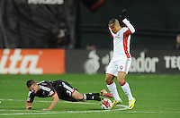 Washington, D.C.- March 29, 2014. Perry Kitchen (23) of D.C. United gets fouled by Charlie Davies (9) of the New England Revolution.  D.C. United defeated the New England Revolution 2-0 during a Major League Soccer Match for the 2014 season at RFK Stadium.