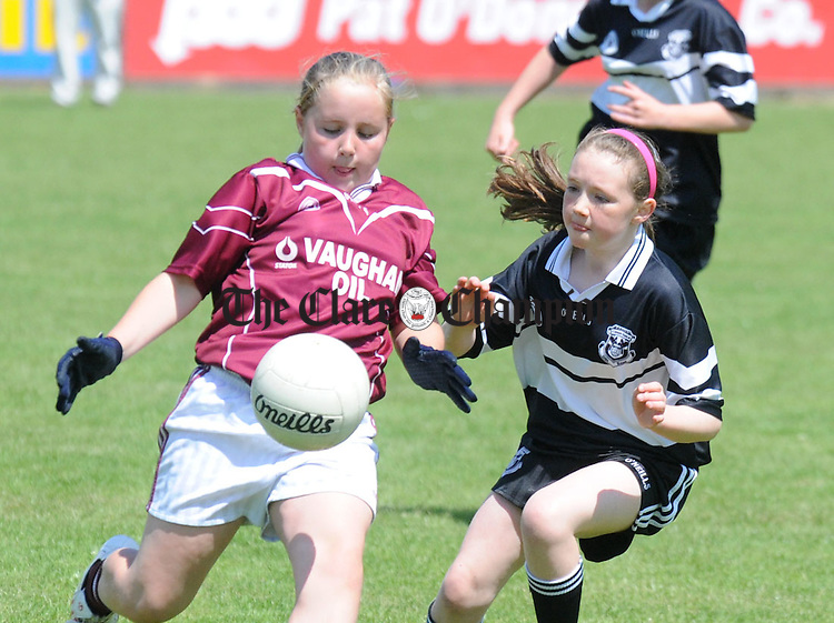 Niamh Kelly of Lisdoonvarna watched by Doonbeg's Aisling O' Mahoney. Photograph by Declan Monaghan