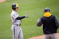 Taylor Doggett #21 of the Wichita State Shockers fist bumps a coach during a game against the Missouri State Bears at Hammons Field on May 5, 2013 in Springfield, Missouri. (David Welker/Four Seam Images)