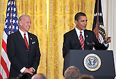 Washington, DC - January 30, 2009 -- United States President Barack Obama, right, makes remarks as he and Vice President Joseph Biden, left, announce Labor Executive Orders and the establshment of the Middle Class Working Families Task Force in the East Room of the White House in Washington, DC on Friday, January 30, 2009.  .Credit: Ron Sachs - CNP