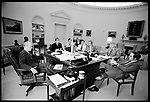 President Gerald Ford with advisors including, on the far right, Dick Cheney, The Oval Office, The White House, Washington, D.C., May 1976