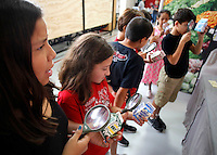 NWA Democrat-Gazette/DAVID GOTTSCHALK Sara Romero (left), a fifth grade student at Harp Elementary School, examines a milk carton Friday, September 11, 2015 along with other students as they participate in the To The Market station of the Farm and You agricultural program at the school in Springdale. Students at the school rotated through nine stations with different interactive activities about the importance of food, farms and good health.