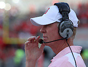 Head Coach Tom O'Brien makes a call. NC State defeated Central Michigan 38-24 on Saturday, October 8, 2011 at Carter-Finley Stadium in Raleigh. Photo by Al Drago.