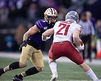 Elijah Molden closes in on Cougar running back Max Borghi.