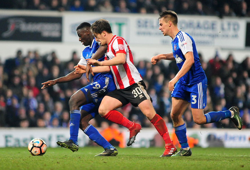 Lincoln City's Alex Woodyard vies for possession with Ipswich Town's Josh Emmanuel<br /> <br /> Photographer Andrew Vaughan/CameraSport<br /> <br /> Emirates FA Cup Third Round - Ipswich Town v Lincoln City - Saturday 7th January 2017 - Portman Road - Ipswich<br />  <br /> World Copyright &copy; 2017 CameraSport. All rights reserved. 43 Linden Ave. Countesthorpe. Leicester. England. LE8 5PG - Tel: +44 (0) 116 277 4147 - admin@camerasport.com - www.camerasport.com