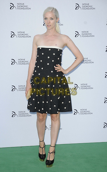 Portia Freeman<br /> The Novak Djokovic Foundation London gala dinner, The Roundhouse, London, England.<br /> July 8th, 2013<br /> full length strapless dress polka dot black white hand on hip <br /> CAP/CAN<br /> &copy;Can Nguyen/Capital Pictures