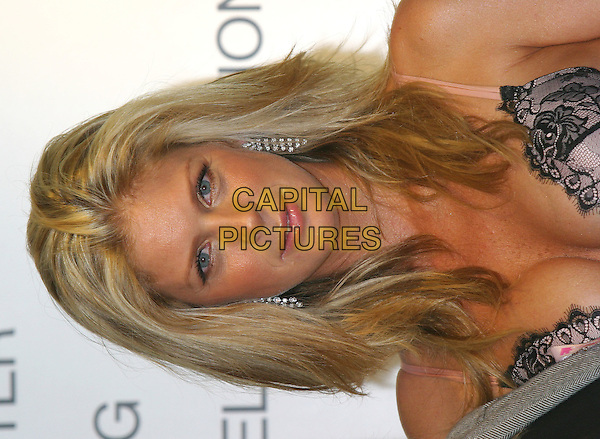 RACHEL HUNTER.Launches Autumn/Winter 2004 Collection for Ultimo Lingerie, Selfridges, London,.5th October 2004..portrait headshot.Ref: BR.www.capitalpictures.com.sales@capitalpictures.com.©Capital Pictures.