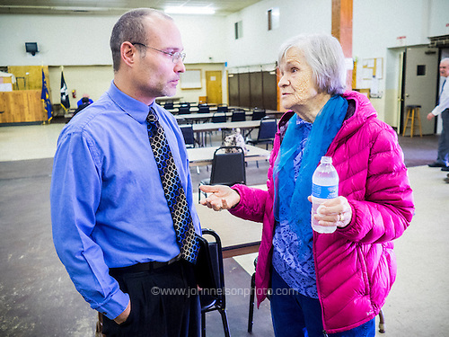 Lake Station mayor Chris Anderson chats with resident Rose Zulich.