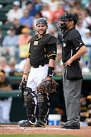 Catcher Russell Martin (55) of the Pittsburgh Pirates and umpire Adrian Johnson during a spring training game against the New York Yankees on February 26, 2014 at McKechnie Field in Bradenton, Florida.  Pittsburgh defeated New York 6-5.  (Mike Janes/Four Seam Images)