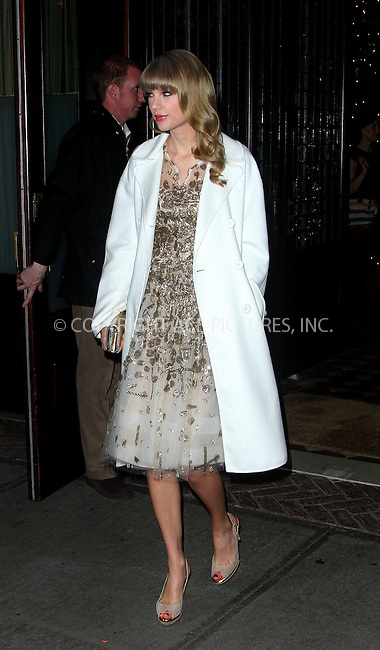 WWW.ACEPIXS.COM......December 3 2012, New York City....Singer Taylor Swift leaves her hotel on December 3 2012 in New York City......By Line: Zelig Shaul/ACE Pictures......ACE Pictures, Inc...tel: 646 769 0430..Email: info@acepixs.com..www.acepixs.com