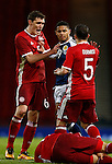 Liam Birdcutt of Scotland is confronted by Andreas Christensen and Riza Durmisi of Denmark after his tackle on Erik Sviatchenko of Denmark (foreground) during the Vauxhall International Challenge Match match at Hampden Park Stadium. Photo credit should read: Simon Bellis/Sportimage