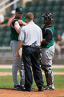 Augusta Green Jackets trainer Dustin Luepker takes a look at the shoulder of relief pitcher Adam Paul (50) after he had been hit by a line drive versus Kannapolis at Fieldcrest Cannon Stadium in Kannapolis, NC, Monday, September 3, 2007.