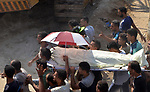 Egyptians carry the body of Sayed Tafshan, who died during clashes between Egyptians security forces and residents in the Warraq district of Giza, southwest of Cairo, Egypt, on July 16, 2017. Egypt's Health Ministry said one person was killed and 19 injured in clashes after police attempted to remove illegal buildings on state land. Photo by Amr Sayed