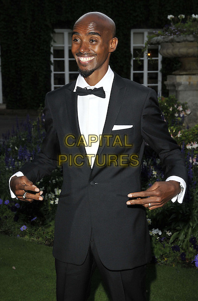 LONDON, ENGLAND - AUGUST 28: Mo Farah attends the Mo Farah Foundation &quot;A Night Of Champions&quot; Dinner, The Hurlingham Club, Ranelagh Gardens, on Thursday August 28, 2014 in London, England, UK. <br /> CAP/CAN<br /> &copy;Can Nguyen/Capital Pictures