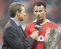 Ryan Giggs #11 of Manchester United is interviewed by Rob Stowe of ESPN during the 2010 MLS All-Star match against the MLS All-Stars at Reliant Stadium, on July 28 2010, in Houston, Texas. Manchester United won 5-2.