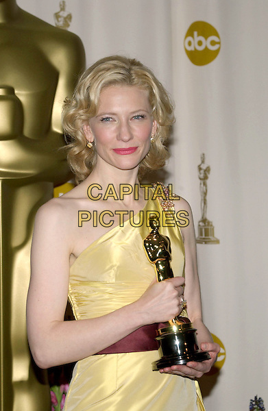CATE BLANCHETT.77th Annual Academy Awards held at the Kodak Theatre.February 27th, 2005.Photo Credit: Jacqui Wong/AdMedia.oscars half length award trophy one shoulder off the shoulder yellow silk satin.www.capitalpictures.com.sales@capitalpictures.com.© Capital Pictures.