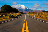 Looking east down State Highway 47 at National Park to Mount Ngauruhoe, Ruapehu, Central North Island, New Zealand