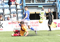 Declan Gallagher makes a timely tackle on Connor Murray in the SPFL Betfred League Cup group match between Queen of the South and Motherwell at Palmerston Park, Dumfries on 13.7.19.