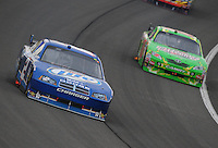 Feb 22, 2009; Fontana, CA, USA; NASCAR Sprint Cup Series driver Kurt Busch leads brother Kyle Busch during the Auto Club 500 at Auto Club Speedway. Mandatory Credit: Mark J. Rebilas-