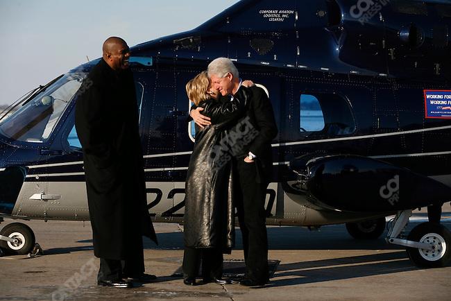 "Senator Hillary Clinton, with former President Bill Clinton, and basketball star Earvin ""Magic' Johnson, Des Moines, Iowa, December 18, 2007"