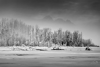 Winter landscape of frozen Matanuska River with fog partly obscuring Pioneer Peak and Twin Peaks.  Matanuska Valley Chugach Mountains<br /> <br /> Photo by Jeff Schultz/SchultzPhoto.com  (C) 2017  ALL RIGHTS RESERVED