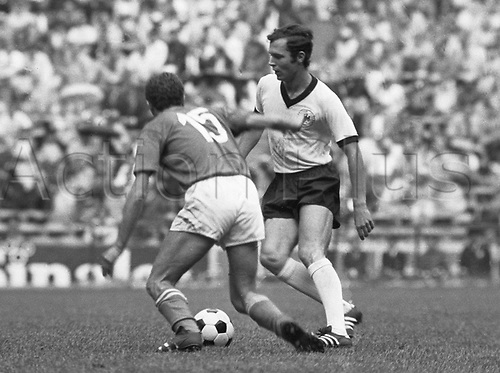1970 World Cup Finals Mexico: German captain Franz Beckenbauer (r) in a challenge with Italian defender on 17.06.1970 in Aztec Stadium in Mexico.