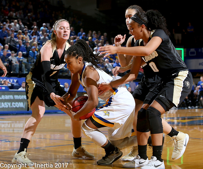 BROOKINGS, SD - MARCH 19:  Alexis Alexander #1 from South Dakota State grabs the loose ball between a trio of defenders from Colorado during their second round WNIT game at Frost Arena March 19, 2017 in Brookings, South Dakota. (Photo by Dave Eggen/Inertia)