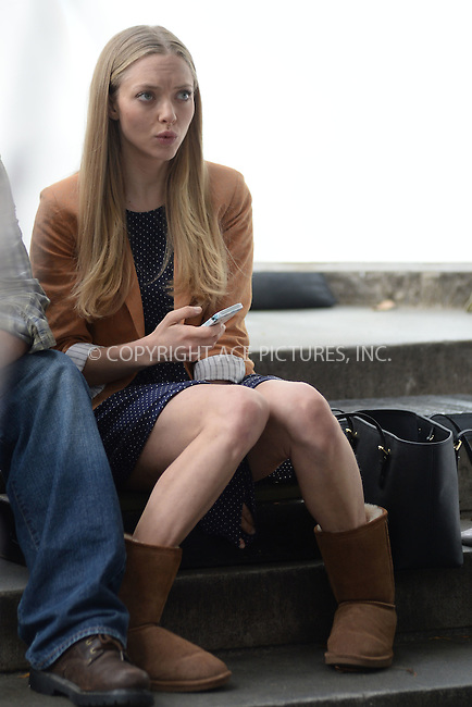 WWW.ACEPIXS.COM<br /> October 7, 2014 New York City<br /> <br /> Amanda Seyfried on location for Ted 2 at The NY Public Library in Midtown on October 7, 2014 in New York City.<br /> <br /> By Line: Kristin Callahan/ACE Pictures<br /> ACE Pictures, Inc.<br /> tel: 646 769 0430<br /> Email: info@acepixs.com<br /> www.acepixs.com