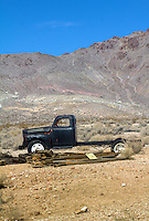 Abandoned truck in the Ghost Town of Rhyloite Nevada.<br /> <br /> Rhyolite is a ghost town in Nye County, in the U.S. state of Nevada. It is located in the Bullfrog Hills, about 120 miles (190 km) northwest of Las Vegas, near the eastern edge of Death Valley.