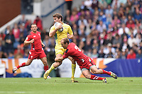 Australia's Con Foley is tackled by Wales's Lee Williams<br /> <br /> Australia Vs Wales - Men's quarter-final<br /> <br /> Photographer Chris Vaughan/CameraSport<br /> <br /> 20th Commonwealth Games - Day 4 - Sunday 27th July 2014 - Rugby Sevens - Ibrox Stadium - Glasgow - UK<br /> <br /> © CameraSport - 43 Linden Ave. Countesthorpe. Leicester. England. LE8 5PG - Tel: +44 (0) 116 277 4147 - admin@camerasport.com - www.camerasport.com
