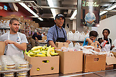 United States President Barack Obama helps pack food donation bags at Food & Friends as part of the National Day of Remembrance and Service in Washington, D.C. on September 11, 2013. Obama volunteered his time on the 12th Anniversary of the terrorist attacks on 9/11.  <br /> Credit: Kevin Dietsch / Pool via CNP