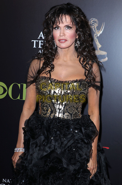 MARIE OSMOND .37th Annual Daytime Emmy Awards held at The Hilton Hotel Casino, Las Vegas, Nevada, USA, .27th June 2010.half length black sheer see thru though dress gold sequined sequin bodice sleeves .CAP/ADM/MJT.© MJT/AdMedia/Capital Pictures.
