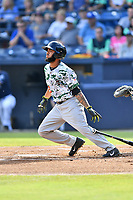 Augusta GreenJackets center fielder Cristian Paulino (9) swings at a pitch during a game against the Asheville Tourists at McCormick Field on July 15, 2017 in Asheville, North Carolina. The Tourists defeated the GreenJackets 2-1. (Tony Farlow/Four Seam Images)