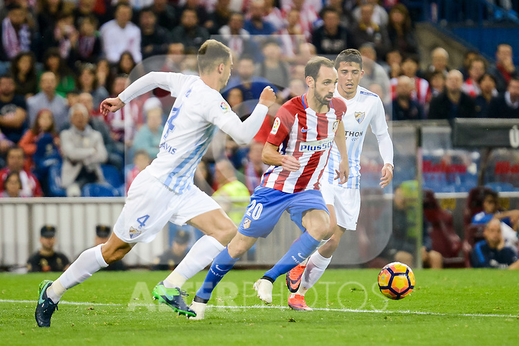 Atletico de Madrid's player Juanfran Torres and Malaga CF Mikel Villanueva Alvarez during a match of La Liga Santander at Vicente Calderon Stadium in Madrid. October 29, Spain. 2016. (ALTERPHOTOS/BorjaB.Hojas)