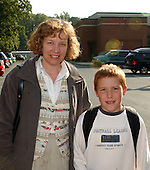 Kensington, MD - October 23, 2002 -- Susan De Ford, left, walks her son, Ryan, home from Oakland Terrace Elementary School in Kensington, MD on 23 October, 2002.<br /> Credit: Ron Sachs / CNP<br /> (RESTRICTION: NO New York or New Jersey Newspapers or newspapers within a 75 mile radius of New York City)