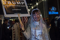 NY, NEW YORK, NOVEMBER 8: People stand on the streets outside President elect Donald Trump&rsquo;s election headquarters at the Hilton Midtown to celebrate his victory in New York on November 8,2016<br />  Photo by VIEWpress/Maite H. Mateo.