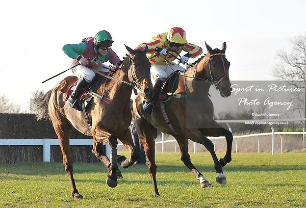 Miko De Beauchene ridden by R T Dunne (left) and Wide Receiver ridden by Felix De Giles. Race 5. ladbrokes.com Kent National (Handicap Chase). Kent National Day. Folkestone Racecourse. Folkestone. Kent. 29/02/2012. MANDATORY Credit Garry Bowden/Sportinpictures - NO UNAUTHORISED USE - 07837 394578.