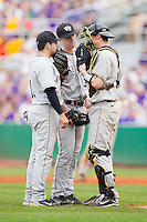 Pat Blair #11, Tim Cooney #35 and Mike Lubanski #10 of the Wake Forest Demon Deacons have a meeting on the mound during their game against the LSU Tigers at Alex Box Stadium on February 19, 2011 in Baton Rouge, Louisiana.  The Tigers defeated the Demon Deacons 4-3.  Photo by Brian Westerholt / Four Seam Images