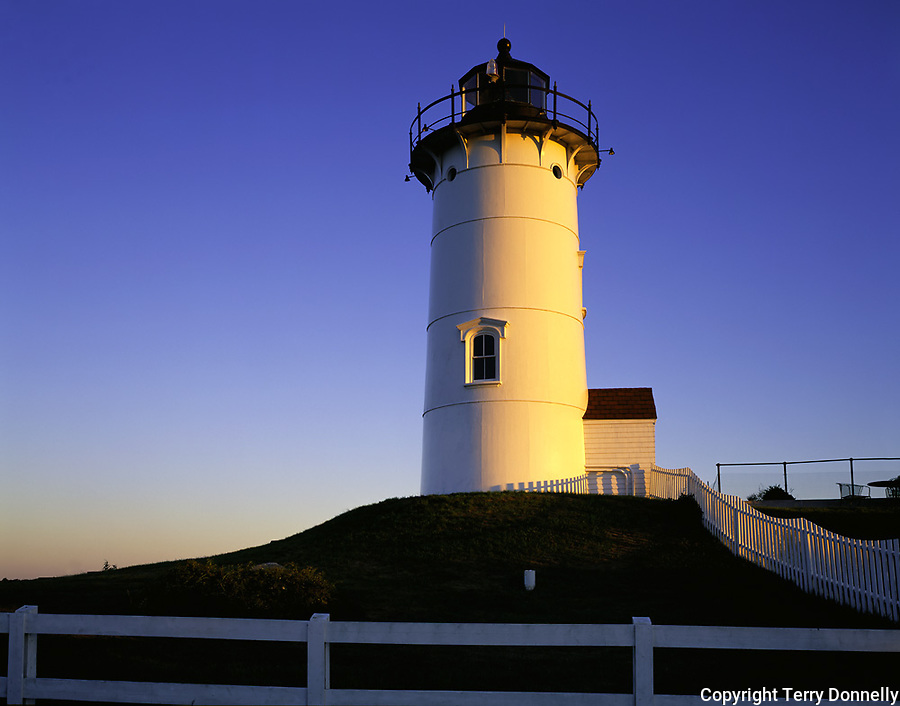 Cape Cod National Seashore, MA <br /> Nobska Point Light (1876) at dawn above Woods Hole on Nantucket Sound