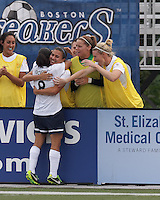 Sky Blue FC forward Monica Ocampo (8) celebrates her goal with teammates.  In a National Women's Soccer League Elite (NWSL) match, Sky Blue FC (white) defeated the Boston Breakers (blue), 3-2, at Dilboy Stadium on June 16, 2013.