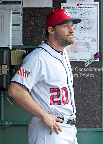 Washington Nationals second baseman Daniel Murphy (20), who was given the night off, watches the action from the dug-out during the game against the New York Mets at Nationals Park in Washington, D.C. on Monday, July 3, 2017.  The Nationals won the game 3 - 2.<br /> Credit: Ron Sachs / CNP<br /> (RESTRICTION: NO New York or New Jersey Newspapers or newspapers within a 75 mile radius of New York City)