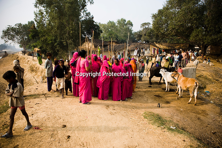 Amidst the gloom of extreme poverty, it's the colour of pink that's calling the shots in this dusty region of Bundelkhand, one of the poorest parts of one of India's northern and most populous states, Uttar Pradesh in India. A gang of vigilantes, called the Gulabi Gang (pink gang) - its 10,000 strong women members wear only pink sarees - is taking up lathi (traditional Indian cudgel) against domestic violence and corruption. ..The 47-year-old leader of the Pink Gang, Sampat Pal Devi is a fiesty woman. The barely educated, impoverished mother of five, Sampat Pal Devi has emerged as a messianic figure in the region. Sampath Devi began to work as a government health worker, but she quit soon after because her job was not satisfying enough. She always wanted to work for the poor and not for herself. Taking up issues while being a government worker was difficult, so she decided to quit the job and work for the rights of people.