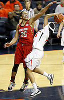 Maryland forward Alyssa Thomas (25) defends Virginia guard Ataira Franklin (23) during the game Thursday in Charlottesville, VA. Virginia defeated Maryland 86-72. Photo/The Daily Progress/Andrew Shurtleff
